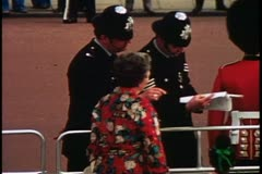 Faces, two bobbies direct a tourist, London, England, 1976, London 1970's Stock Footage