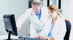 Caucasian Doctors Checking Medical Information on computer  - stock footage