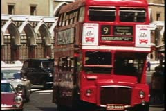 Double decker bus on the street in London, England, 1976, London 1970's Stock Footage