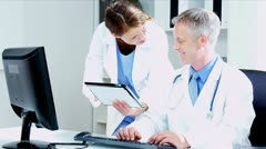 Caucasian Doctors Checking Medical Information on tablet  - stock footage