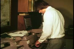 International Currency trading room, Barclay's. London, 1970's teletype machine Stock Footage