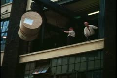 Fleet Street, close up hoisting giant roll, London, England, 1970's loading dock Stock Footage