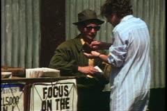 Fleet Street, newspaper seller, woman buyer, London, England, 1970's Stock Footage
