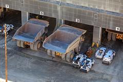 mine trucks in maintenance 0793.jpg - stock photo