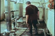 Whitbread brewery, man samples and tests, London, England, 1970's Stock Footage
