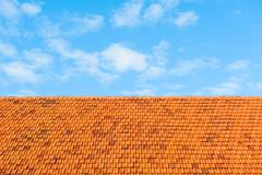 roof tiles and sky with clouds - stock photo