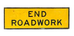 Old end roadwork traffic sign Stock Photos