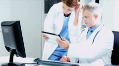 Caucasian  Medical Colleagues Patient Test on tablet computer Results  - stock footage