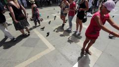 Children feeding pigeons in Venice Italy Stock Footage