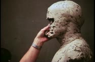 Madame Tussad's Wax Museum, London, 1970's, artist working on clay head Stock Footage