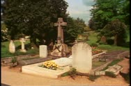 Stock Video Footage of St Martin's Church, Bladon, England, graveyard, wide shot Churchill grave