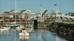 Sailboat drawbridge Maine fishing village Stock Footage