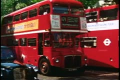 Double Decker Bus, medium shot pass by, London, England, 1976, London 1970's - stock footage