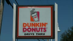 Dunkin Donuts sign and coffee shop Stock Footage