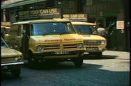 Stock Video Footage of Fleet Street, yellow delivery truck pulls away, London, England, 1970's