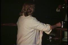 George Inn, barmaid washes glasses, London, England, 1970's Stock Footage