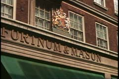 Fortnum and Mason, close up royal warrant sign, 1976, London, England, 1970's Stock Footage