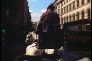 A horse drawn beer wagon moving through streets of London, England, 1976. Stock Footage