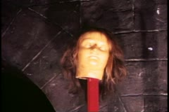 Madame Tussad's Wax Museum, London, 1970's close up head on a stake in wax Stock Footage