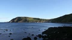 Distant view of Crovie waterfront Scotland Stock Footage