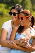 Stock Photo of mother and daughter relaxing in park smiling