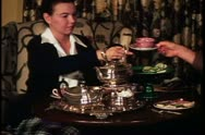 Four O'clock tea, couple at home, talent cleared, pour water, London, England Stock Footage