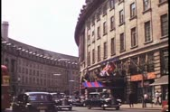 Stock Video Footage of Piccadilly Circus, Regent Street, curve, traffic, 1976, London, England, 1970's