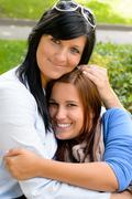 Mother holding teen daughter in her arms Stock Photos
