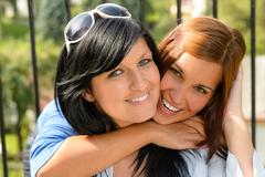 Stock Photo of daughter hugging her mother outdoors happy loving