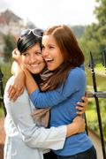 Mother kissing her daughter happy embrace outdoors Stock Photos