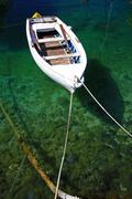 Fishing boat on emerald waters Stock Photos