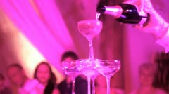 Champagne glasses tower serving Stock Footage