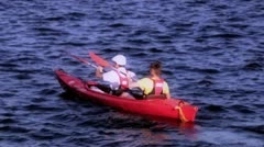 Paddlers in red kayak Stock Footage