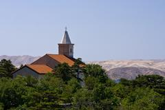 Stock Photo of Church on the hill looking at the sea and island