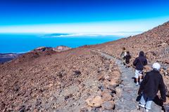 family of tourists exploring the teide tenerife - stock photo