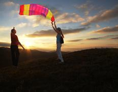 girl and boy flying a kite - stock photo