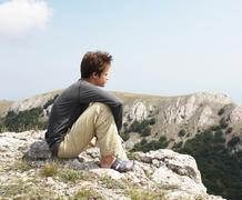 boy on the cliff - stock photo