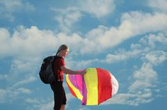 happy young woman flying a kite - stock photo