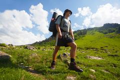 Backpacker in mountain Stock Photos
