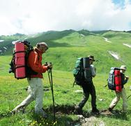 backpackers family  in  mountains - stock photo