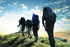 Hikers in  mountains Stock Photos