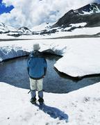 Boy on mountain lake Stock Photos