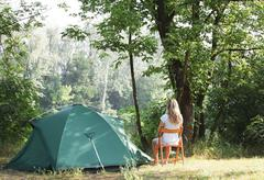 tent in summer forest - stock photo
