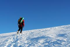 Backpacker  in the winter mountain Stock Photos