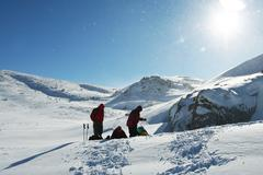 Backpackers in winter mountain Stock Photos