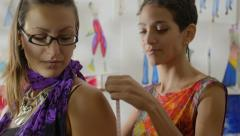 Fashion designer using measuring tape with female client in studio Stock Footage