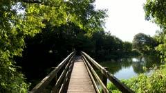 Bridge Over Gentle Summer River Stock Footage