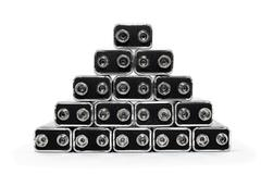 Nine volt batteries forming a pyramid - stock photo