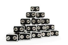 Nine volt batteries forming a triangle - stock photo