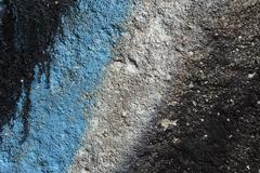 Graffiti detail on a grainy concrete wall Stock Photos